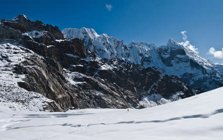 Crossing the Cho La pass in Himalayas. Pictured in Nepal at height 5400 m photo