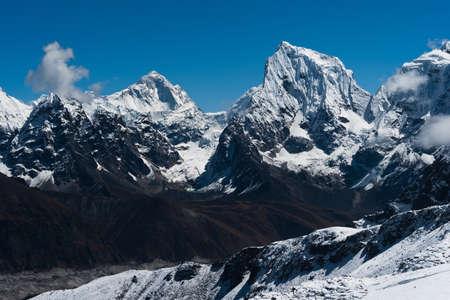 Makalu, Cholatse summits and side of Taboche viewed from Renjo Pass in Himalayas photo