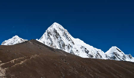 Pumori and Kala Patthar mountains in Himalayas. At height 5100 m photo