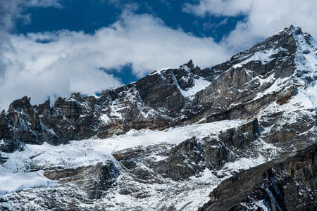 ri: Rocks and snow viewed from Gokyo Ri summit in Himalayas. Travel to Nepal