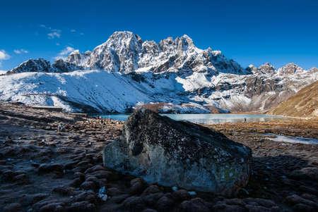 Sacred Gokyo Lake near village and mountain peaks in Himalayas. Travel to Nepal photo
