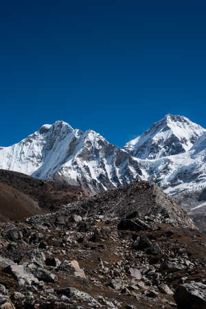 Snowbound mountain peaks and blue sky in Himalayas. Travel to Nepal photo