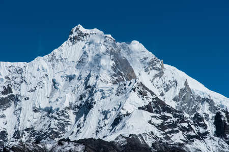 alpinism: Snowbound mountain peaks in Himalayas  Alpinism and hiking Stock Photo