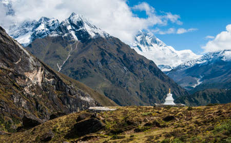 Buddhist stupe or chorten and Lhotse peaks in Himalayas. Religion in Nepal photo