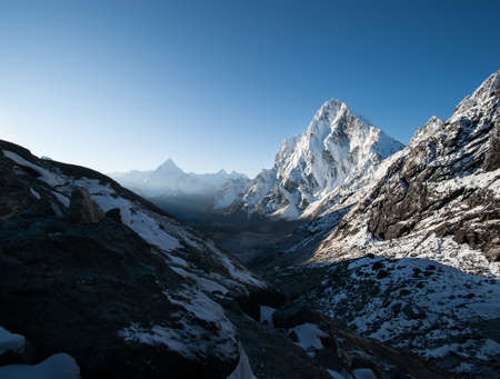 Cho La pass and snowed peaks at dawn in Himalayas. Climbing in Nepal photo