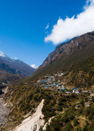 Himalayas Landscape: highland village and mountains. Travel to Nepal photo