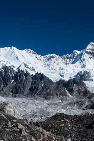 vicinity: Mountain summits in the vicinity of Cho oyu peak. Travel to Nepal Stock Photo