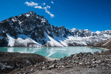 Sacred Lake and peaks near Gokyo in Himalayas. Travel to Nepal photo