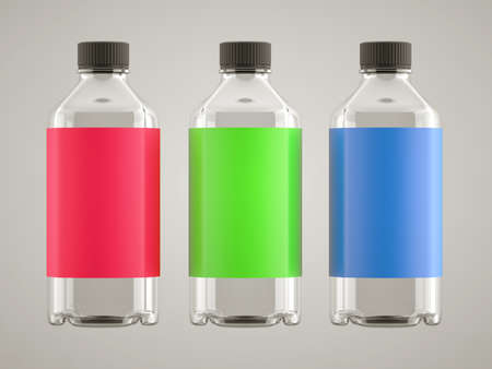 remedy: Three bottles for chemicals or fluids with colorful stickers over grey background Stock Photo