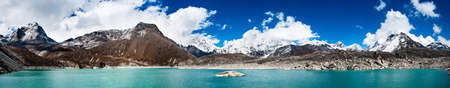 Himalaya panorama: sacred lake near Gokyo and Everest summit in the right part of the image. Travel to Nepal