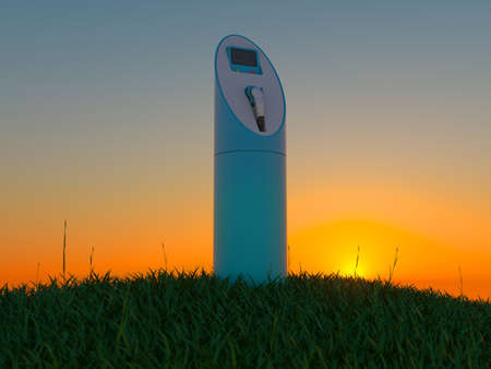 Charging station in the green field at dawn photo