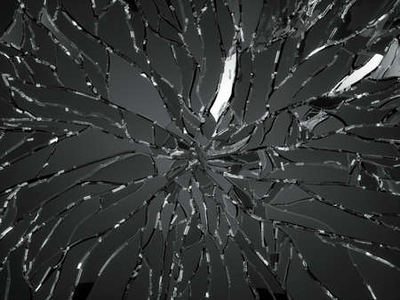 Sharp Pieces of shattered black glass isolated on black photo