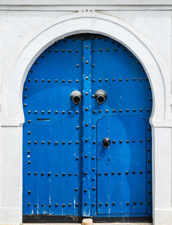 Blue gate and door with ornament from Sidi Bou Said in Tunisia photo