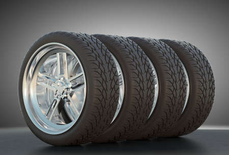 four wheel drive: Group of four automotive wheels with studio light background Stock Photo