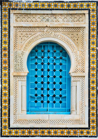 Traditional window with pattern and tiles from Sidi Bou Said in Tunisia photo
