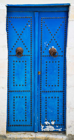 Blue aged door with ornament from Sidi Bou Said in Tunisia. Large resolution photo