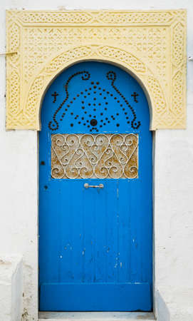 Blue door with ornament and arch from Sidi Bou Said in Tunisia. Large resolution photo