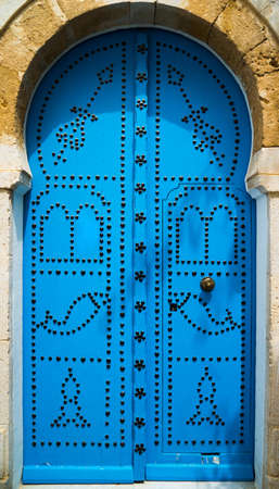 Traditional blue door from Sidi Bou Said in Tunisia. Large resolution photo