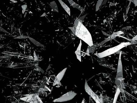 Shattered or damaged pieces of glass isolated on black photo