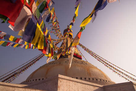 bodnath: Colorful Prayer flags and Boudhanath stupa in Kathmandu  buddhism and religion