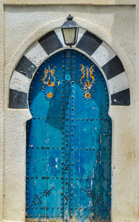 sidi bou said: Old Blue door with arch from Sidi Bou Said in Tunisia