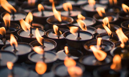 Group of Candles at Buddhist temple. Close up capture photo