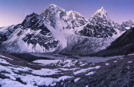 Sunrise in the Himalays. Taboche and Cholatse Mountain peaks photo