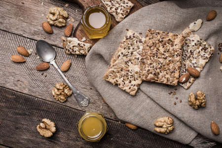herfst eten: Cookies with seeds,  honey on napkin and wooden table. Rustic style and autumn food photo