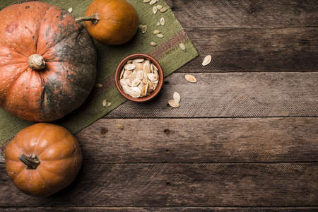 Rustic style pumpkins with seeds on wooden table. Autumn Season food photo photo