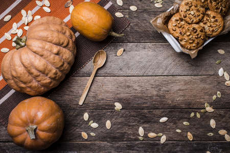 Pumpkins and cookies on wood in Rustic style. Autumn Season food photo photo