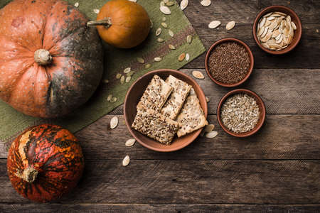 Pumpkins with cookies and seeds on wood in Rustic style. Autumn Season food photo photo