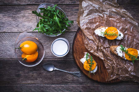 Bruschetta with tomatoes, joghurt and rucola on board in rustic style. Food photo photo