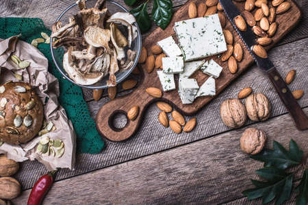 cheese knife: rustic style cheese with bread, cep and nuts. Food photo
