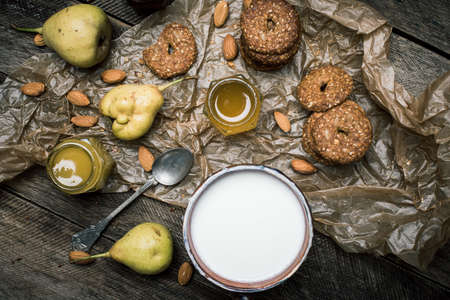 rustic food: pears Cookies and sour cream on wooden table. Rustic style and autumn food photo