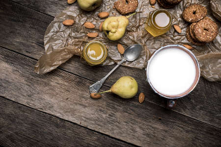autumn food: Nuts pears Cookies and milk on wooden table. Rustic style and autumn food photo Stock Photo