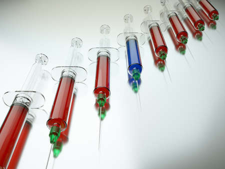 medical choice: Red syringe among blue ones as right medical choice. Large resolution