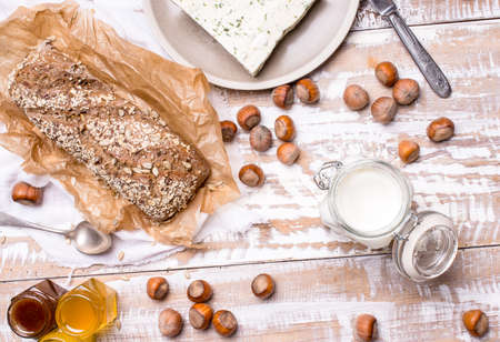 dill seed: Bread with seeds and cheese for breakfast on board in rustic style Stock Photo