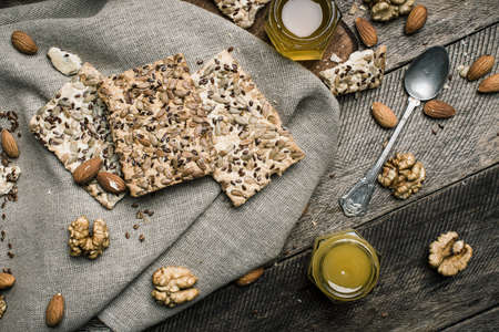 herfst eten: dietic Cookies with seeds nuts honey on wood. Rustic style and autumn food photo