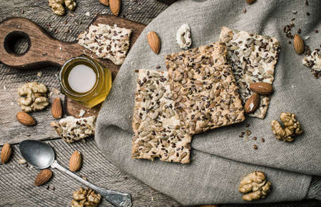 herfst eten: dietic cookies honey and nuts on rustic table. Rustic style and autumn food photo