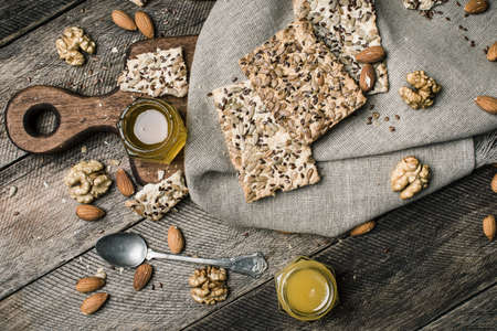autumn food: Cookies with seeds, nuts, honey on wooden table. Rustic style and autumn food photo