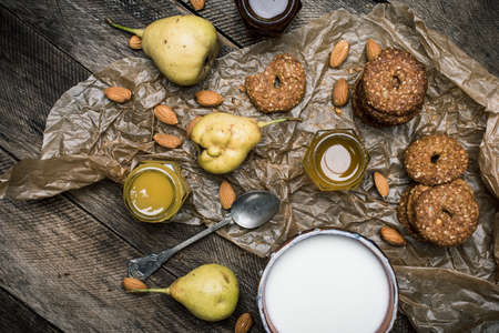 herfst eten: Almonds pears Cookies and joghrut on wood boards. Rustic style and autumn food photo