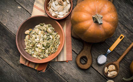 autumn food: Rustic style pumpkins with seeds on wood. Autumn Season food photo