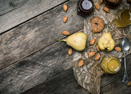 wooden table: pears Cookies honey and nuts on wooden table. Rustic style and autumn food photo