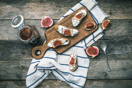 rustic food: rustic style Bruschetta with cheese and figs on napkin. Breakfast, lunch food photo