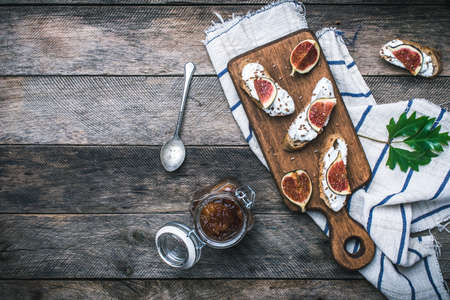 jam sandwich: tasty Snacks with cheese jam and figs on wood. Breakfast, lunch food photo