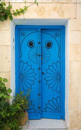 sidi bou said: Traditional blue door from Sidi Bou Said in Tunisia. Tunisian culture