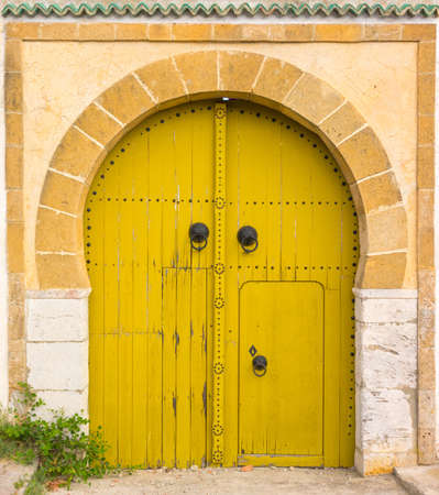Yellow gates with door and ornament from Sidi Bou Said. Tunisian culture