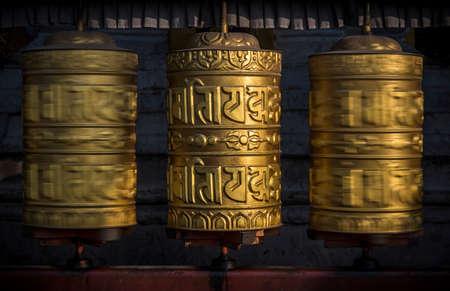 Buddhist shiny prayer wheels in motion. Nepal, Kathmandu