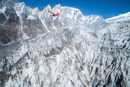 Ultralight plane flies over Pokhara and Machapuchare in Annapurna region, Nepal