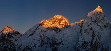 Everest and Nuptse summits at sunset or sunrise. Everest base camp trek, tourism in Nepal